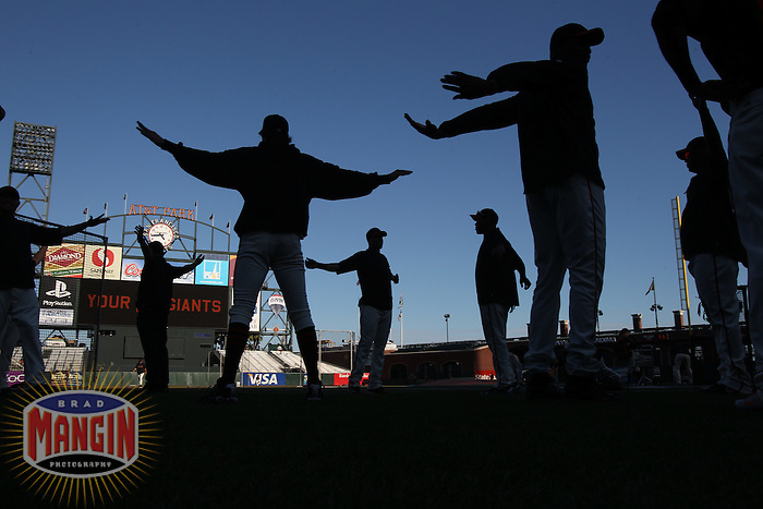 SAN FRANCISCO - October 1:  Members of the San Francisco Giants stretch on the field before the game against the San Diego Padres at AT&T Park on October 1, 2010 in San Francisco, California. (Photo by Brad Mangin)