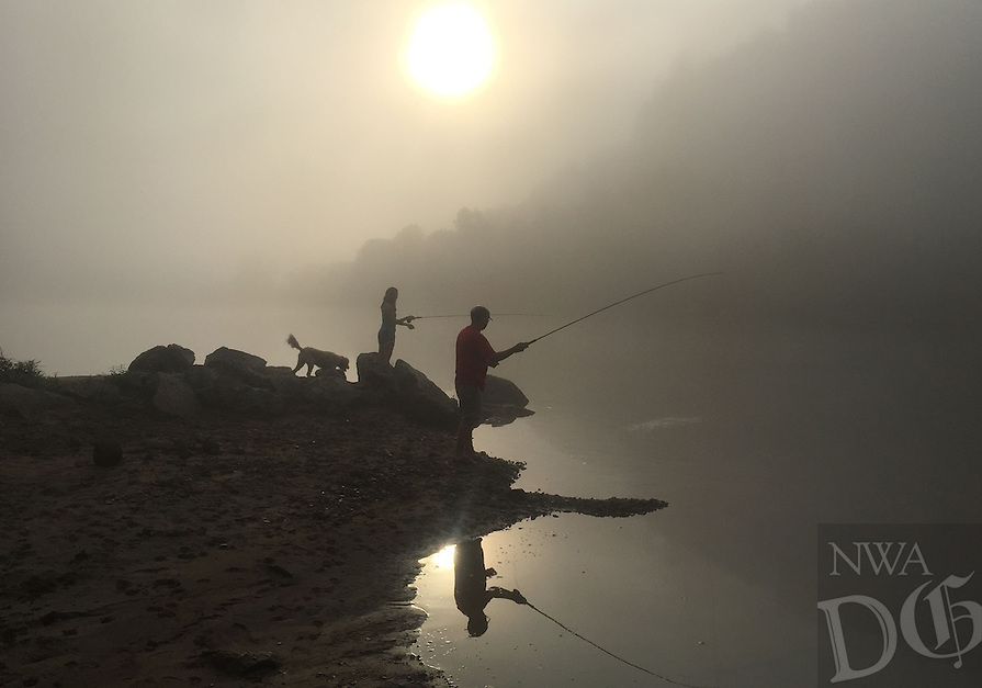 Courtesy photo/LANDON SCHROCK<br /> FOGGY MORNING ANGLERS<br /> Beth Bowen (left) and Jerry Bowen fish for trout at the White River below Bull Shoals Dam Aug. 27. Landon Schrock of Rogers took the picture at Red's Landing.