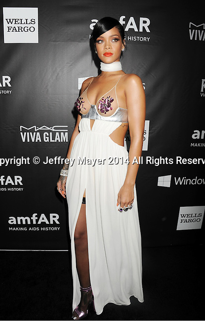 HOLLYWOOD, CA- OCTOBER 29: Recording artist Rihanna attends amfAR LA Inspiration Gala honoring Tom Ford at Milk Studios on October 29, 2014 in Hollywood, California.
