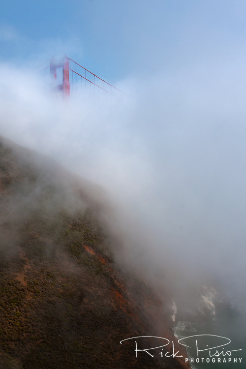 Fog transcends the Marin Headlands covering the Golden Gate Bridge leaving only the top of the North Tower exposed.