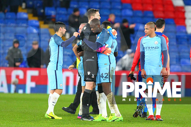 Manchester City goalscorer Yaya Toure with Crystal Palace goalkeeper Wayne Hennessey at the final whistle during the FA Cup fourth round match between Crystal Palace and Manchester City at Selhurst Park, London, England on 28 January 2017. Photo by PRiME Media Images / Steve McCarthy.