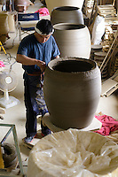 A potter making a pot at the Mori Touki kiln (Otani pottery), Naruto, Tokushima Prefecture, Japan, July 8, 2014. The city of Naruto in Tokushima Japan is famous for whirlpools that form in the Naruto Strait. It is home to Otani pottery and the first two temples on the Shikoku 88 temple pilgrimage.