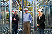 "Ed Begley Jr.,  Rachelle Carson-Begley and general contractor Scott Harris.  On 3/14/2013 the steel framing continues to be assembled over the foundation on the Begley's new home. Steel, while not a common material for residential framing, is 94% recyclable, has been milled locally for this project, and is a more sustainable choice than wood, which is typically used for residential building construction. Ed Begley Jr. (noted actor and environmentalist) and his wife Rachelle Carson-Begley are building their new home under LEED Platinum Certified standards in an attempt to become North America's greenest, most sustainable home. It is also being filmed for their web series ""On Begley Street."" Studio City, California, USA"