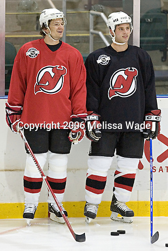 Patrik Elias and Matthew Corrente wait for their turn in a drill. The New Jersey Devils and prospects took part in their second official on-ice day of training camp on Saturday, September 16, 2006 at the Richard E. Codey Rink at South Mountain in West Orange, New Jersey.<br />