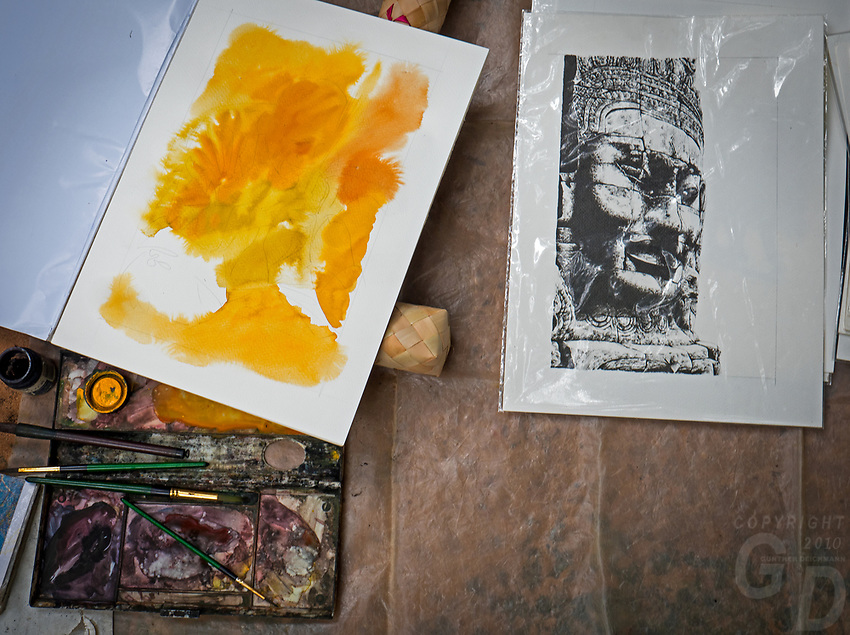 Paintings by talented local Khmer artist at the Bayon Temple producing and selling their artwork to tourist.