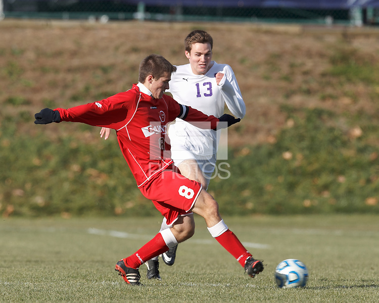 St. Lawrence midfielder Mark Provost (8) passes the ball as Amherst forward Christopher Martin (13) closes. NCAA Division III Sectionals. In double-overtime, Amherst College (white) defeated St. Lawrence University (red), 2-1, on Hitchcock Field at Amherst College on November 23, 2013.
