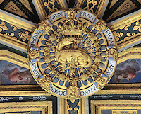 Carved and painted ceiling of the Chapelle Haute Saint-Saturnin, begun 1540s under Francois I and decorated by Philippe Delorme, with gilded sculpture of a golden salamander in flames, symbol of Francois I, at the Chateau de Fontainebleau, France. The chapel was built with 2 storeys, the upper section for the use of royalty. The Palace of Fontainebleau is one of the largest French royal palaces and was begun in the early 16th century for Francois I. It was listed as a UNESCO World Heritage Site in 1981. Picture by Manuel Cohen