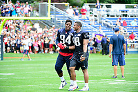 July 28, 2017: New England Patriots defensive end Kony Ealy (94) and defensive lineman Trey Flowers (98) shake hands at at the New England Patriots training camp held at Gillette Stadium, in Foxborough, Massachusetts. Eric Canha/CSM