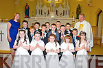 Pupils from Scoil Naomh Eirc, Kilmoyley who received their First Holy Communion last Saturday afternoon in the Sacred Heart church, Kilmoyley were front l-r: Angela O'Carroll (teacher), Amy Corridan, Maeve Godley, Abbey O'Sullivan, Sarah Horan and Alana Stritch. Back l-r: Darragh McElligott, Shaun McCabe, Odhran Maunsell, Robert Monaghan, Bobby O'Connor with Fr Tadhg Fitzgerald.