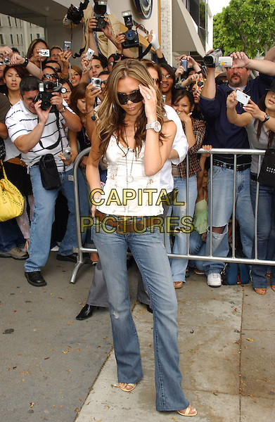 VICTORIA BECKHAM.Promotes her VB Rock & Republic Jeans Collection at Kitson in Los Angeles, California, USA, .June 4th 2005..full length over-sized sunglasses white lace camisole vest top silver necklaces pendant hoop earrings brown belt ring watch hand in hair touching.Ref: DVS.www.capitalpictures.com.sales@capitalpictures.com.©Debbie VanStory/Capital Pictures