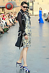 Gwen walks runway in a Douglas Hannant Resort 2012 outfit, on the USS Intrepid, June 7, 2011.