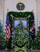 "The 2018 White House Christmas decorations, with the theme ""American Treasures"" which were personally selected by first lady Melania Trump, are previewed for the press in Washington, DC on Monday, November 26, 2018.  The Official White House Christmas tree is seen through the door into the Blue Room from the Grand Foyer.<br /> Credit: Ron Sachs / CNP"