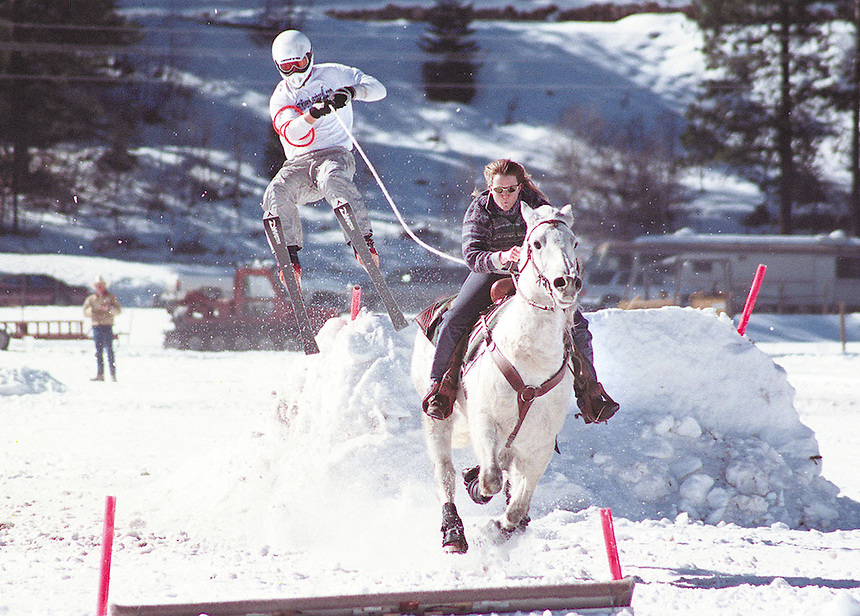 "2001: A competitor in a ""ski-joring"" competition at Vallecito Lake in 2001. Ski Joring is an event where a skier is pulled behind a horse and rider and navigates a slalow course with jumps and collects rings. The event is held annually in Durango, Colorado as part of the annual snowdown festival."