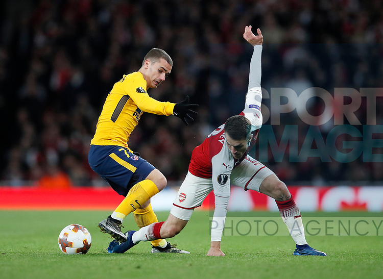 Arsenal's Aaron Ramsey tussles with Atletico's Antoine Griezmann during the Europa League Semi Final 1st Leg, match at the Emirates Stadium, London. Picture date: 26th April 2018. Picture credit should read: David Klein/Sportimage