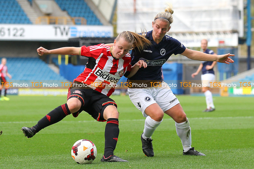 Beth Mead of Sunderland AFC Ladies tangles with Kylie Davies of Millwall Lionesses - Millwall Lionesses vs Sunderland AFC Ladies - FA Womens Super League Football at Milwall FC, the New Den, London - 26/10/14 - MANDATORY CREDIT: Gavin Ellis/TGSPHOTO - Self billing applies where appropriate - contact@tgsphoto.co.uk - NO UNPAID USE
