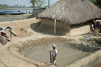 A villager preparing a small pond for shrimp farming. Sunderbans, West Bengal, India. Arindam Mukherjee.