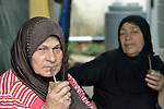 Two women originally from Homs, Syria, share a quiet moment in the Aamer al Sanad refugee settlement in Kab Elias, a town in Lebanon's Bekaa Valley which has filled with Syrian refugees. Lebanon hosts some 1.5 million refugees from Syria, yet allows no large camps to be established. So refugees have moved into poor neighborhoods or established small informal settlements, such as Aamer al Sanad, in border areas. International Orthodox Christian Charities, a member of the ACT Alliance, provides support for refugees in Kab Elias, including a community clinic.<br /> <br /> Parental consent obtained.