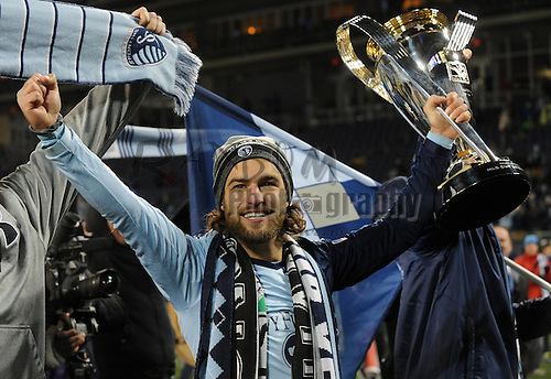 Dec 7, 2013; Kansas City, KS, USA; Sporting KC midfielder/forward Graham Zusi (8) celebrates after the 2013 MLS Cup against Real Salt Lake at Sporting Park. Mandatory Credit: Denny Medley-USA TODAY Sports