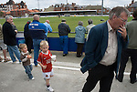 A boy in a Manchester United shirt follows an Alex Ferguson look-a-like. Whitby Town 3 Shildon 2, FA CUP 1st Round Qualifying, 15th September 2007.