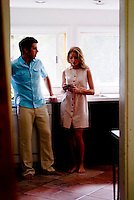 Couple standing in kitchen