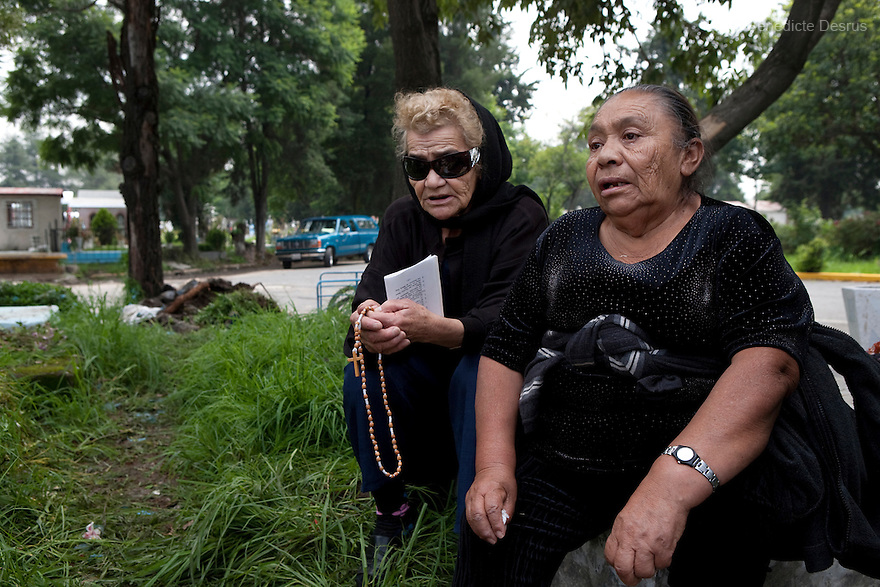 Maria Luisa and Conchita, both residents of Casa Xochiquetzal, attend the funeral of Delia who died after living at the shelter for one year in Mexico City, Mexico on July 18, 2008. Casa Xochiquetzal is a shelter for elderly sex workers in Mexico City. It gives the women refuge, food, health services, a space to learn about their human rights and courses to help them rediscover their self-confidence and deal with traumatic aspects of their lives. Casa Xochiquetzal provides a space to age with dignity for a group of vulnerable women who are often invisible to society at large. It is the only such shelter existing in Latin America. Photo by Bénédicte Desrus