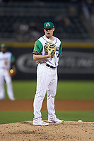 Caballeros de Charlotte relief pitcher Hunter Schryver (34) looks to his catcher for the sign against the Buffalo Bisons at BB&T BallPark on July 23, 2019 in Charlotte, North Carolina. The Bisons defeated the Caballeros 8-1. (Brian Westerholt/Four Seam Images)