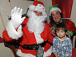 Philip Ross pictured with Santa and Bubbles when he came to St Mary's GAA club in Ardee. Photo: Colin Bell/pressphotos.ie