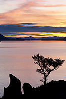 Sunset off the shores of Fort Ambercrombie state park, Kodiak Island, Alaska.