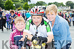 Scartaglen cyclist Liam Murphy is welcomed home by his family Catherine and Ruairi at the finish of the Ring of Kerry cycle in Killarney on Saturday