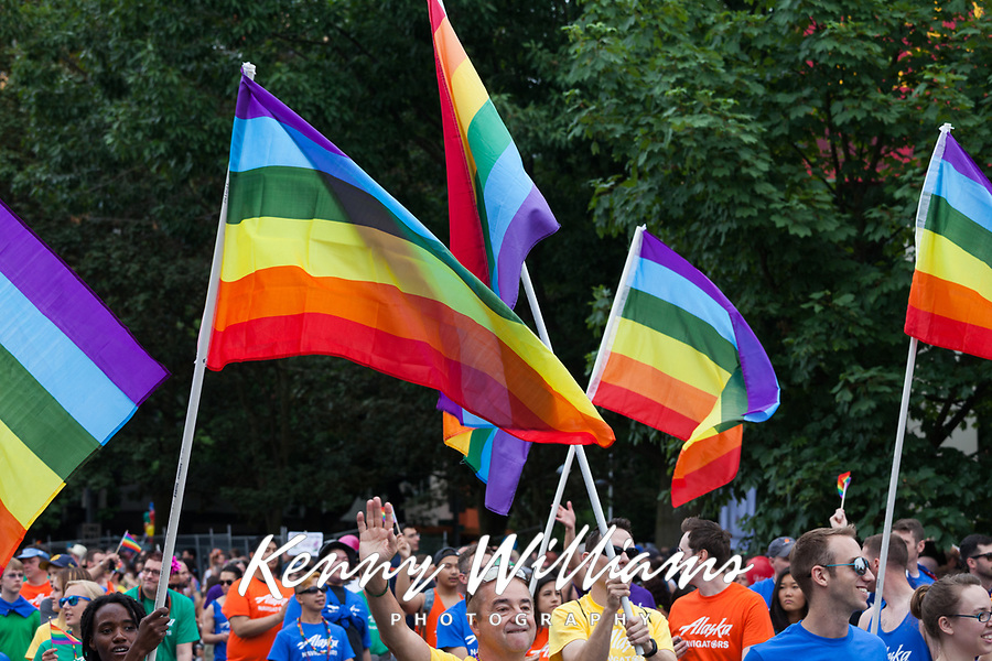 Parade marchers waving rainbow flags, Seattle PrideFest 2015, Washington State, WA, America, USA.