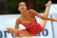 Simona Peycheva of Bulgaria split leaps to toss with rope at 2006 Portimao World Cup of Rhythmic Gymnastics on September 8, 2006.  (Photo by Tom Theobald)