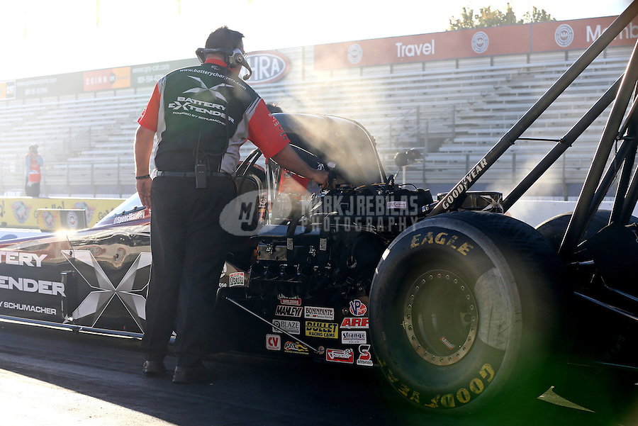 Nov 7, 2013; Pomona, CA, USA; A crew member for NHRA top fuel dragster driver Spencer Massey during qualifying for the Auto Club Finals at Auto Club Raceway at Pomona. Mandatory Credit: Mark J. Rebilas-