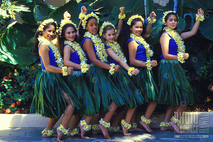 Young girls in plumeria leis and ti leaf costumes