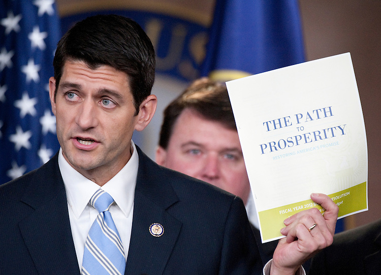 "UNITED STATES - APRIL 5: House Budget Chairman Paul Ryan, R-Wisc., holds a copy of his budget proposal ""The Path to Prosperity"" during a news conference on the FY2012 budget resolution on Tuesday, April 5, 2011. (Photo By Bill Clark/Roll Call)"