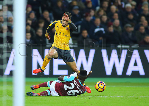 03.12.2016. London Stadium, London, England. Premier League Football. West Ham United versus Arsenal. West Ham United Defender Arthur Masuaku wins a challenge against Arsenal Defender Gabriel Paulista