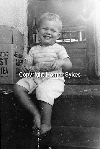 """Homer Vancouver Canada. Back of photo reads """" Our darling Homar, 7 Sept 50 Smiles when he got the extra lumps of butter. """""""