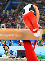 Aug. 9, 2008; Beijing, CHINA; An official appears to sleep as Jonathan Horton (USA) performs on the pommel horse during mens gymnastics qualification during the Olympics at the National Indoor Stadium. Mandatory Credit: Mark J. Rebilas-