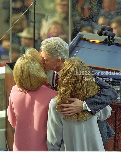 United States President William Jefferson Clinton kisses his wife, Hillary and embraces his daughter Chelsea after taking the oath for his second term in office at the U.S. Capitol on Monday, January 20, 1997.  .Credit: Ron Sachs / CNP