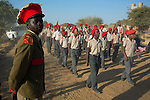 OTJIWARONGO, NAMBIA- AUGUST 12: A Herero inspects  a youth group parading in traditional military uniforms during a march when commemorating fallen chiefs killed in battles with Germans. The area was the venue for decisive battles of the Herero uprisings in 1904.  The Herero accuse the German Empire of Genocide of its people from 1904-07. They are currently trying to make the German government compensate the descendants of the people killed. (Photo by Per-Anders Pettersson)