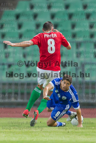 Hungary's Adam Pinter (L) and Israel's Maor Melicsohn (R) fight for the ball during a friendly football match Hungary playing against Israel in Budapest, Hungary on August 15, 2012. ATTILA VOLGYI