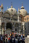 Tourist souvenir stall outside the Basilica di San Marco, St Marks square Venice, Italy.