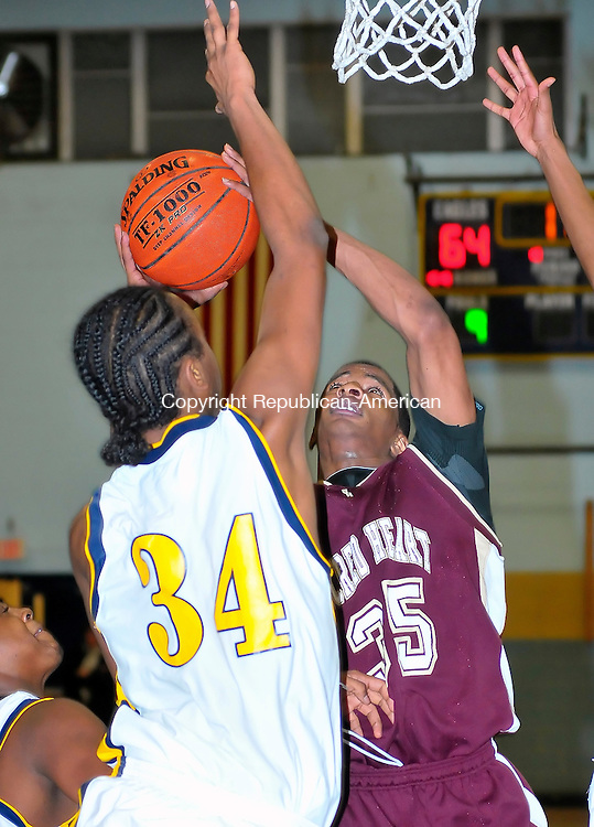 WATERBURY, CT-26 JANUARY 2009-012610JS09-Sacred Heart's Ruben Bergen(35) puts up a shot over Kennedy's Denzel Sanders (34) during their game  Tuesday at Kennedy High School in Waterbury. <br /> Jim Shannon Republican-American