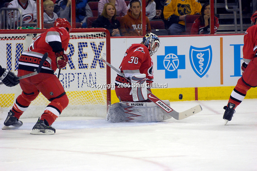 Carolina Hurricane goalie Cam Ward makes a save against the Boston Bruins during an NHL hockey game Saturday, Dec. 2, 2006 in Raleigh, N.C. Carolina won 5-2.<br />