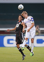 DC United defender Juan Manuel Pena (3) heads the ball against Kansas City Wizards midfielder Chance Myers (7). DC United defeated The Kansas City Wizards  2-0 at RFK Stadium, Wednesday May 5, 2010.