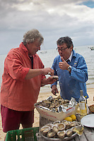 "Europe/France/Aquitaine/33/Gironde/Bassin d'Arcachon/Lège-Cap-Ferret:  Le chef Christian Constant avec   Joël Dupuch, ostréiculteur à Lège-Cap Ferret et  acteur dans le film ""Les Petits mouchoirs"" de Guillaume Canet - Dégustation des Huîtres d' Arcachon . Cap-Ferret des Parcs de l'Impératrice de  Joël Dupuch // France, Gironde, Arcachon Bay, Lege Cap Ferret, Chef Christian Constant by barge on the Bassin d'Arcachon with Joel Dupuch, oyster in Lege Cap Ferret and actor in the film Little White Lies Guillaume Canet , Tasting Arcachon Oysters<br /> <br />  Non destiné à un usage publicitaire - Not intended for an advertising use]"