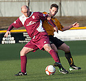 Arbroath player / manager Paul Sheerin holds off Alloa's new boy Kevin Moon.