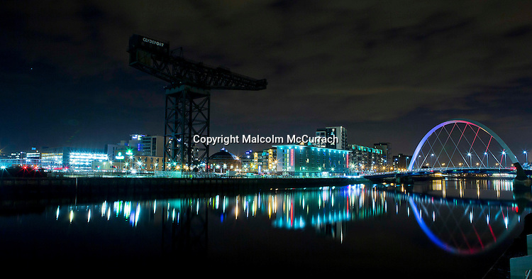 Finnieston crane and The Clyde Arc (aka Squinty Bridge) at night.<br />
