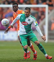 Blackpool's Marc Bola vies for possession with Plymouth Argyle's Antoni Sarcevic<br /> <br /> Photographer Kevin Barnes/CameraSport<br /> <br /> The EFL Sky Bet League One - Blackpool v Plymouth Argyle - Saturday 30th March 2019 - Bloomfield Road - Blackpool<br /> <br /> World Copyright © 2019 CameraSport. All rights reserved. 43 Linden Ave. Countesthorpe. Leicester. England. LE8 5PG - Tel: +44 (0) 116 277 4147 - admin@camerasport.com - www.camerasport.com