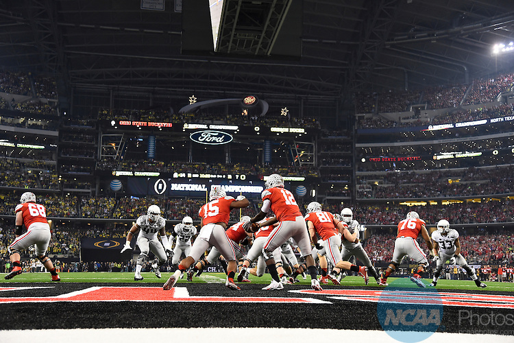 12 JAN 2015:  Cardale Jones (12) of the Ohio State University hands off to Ezekiel Elliott (15) against the University of Oregon during the College Football Playoff National Championship held at AT&T Stadium in Arlington, TX.  Ohio State defeated Oregon 42-20 for the national title.  Jamie Schwaberow/NCAA Photos
