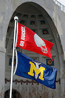 Flags fly before the NCAA football game against Michigan at Ohio Stadium on Saturday, November 29, 2014. (Columbus Dispatch photo by Jonathan Quilter)